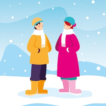 Duas pessoas com roupas de inverno na paisagem com neve
