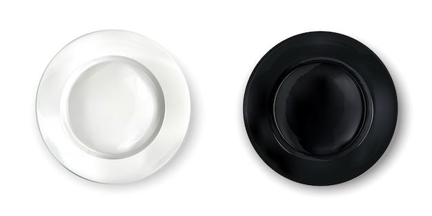 Duas placas redondas vazias - brancas e pretas.