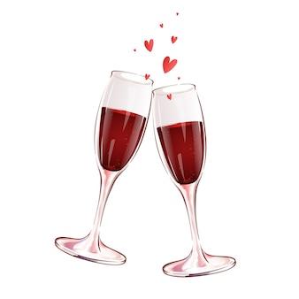 Duas taças de vidro com vinho tinto e corações. brinde festivo.
