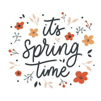 É tempo de primavera letras inscrição com flores. cartão de amor