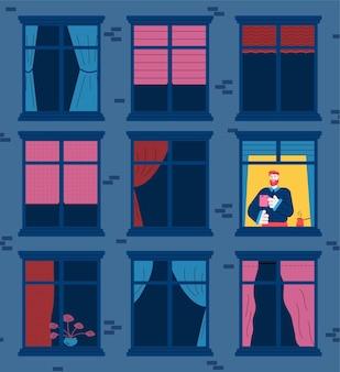 Edifício à noite com janelas vazias com apenas um homem acordado