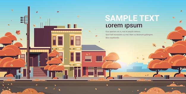 Edifício da cidade casas exterior rua moderna da cidade no outono pôr do sol paisagem urbana