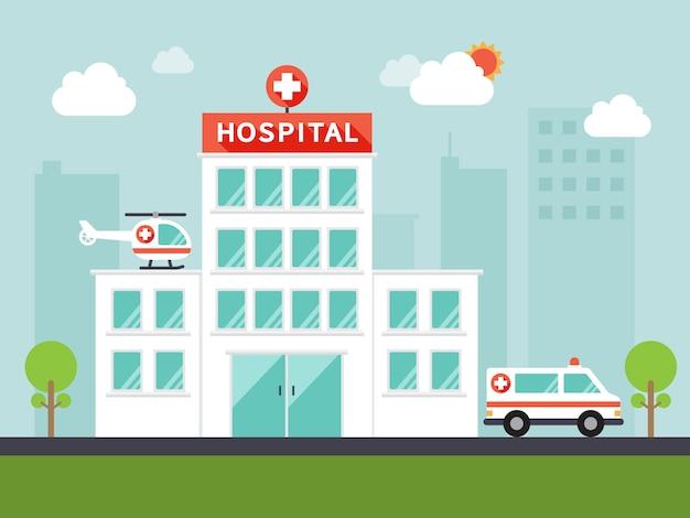 Edifício do hospital da cidade com ambulância e helicóptero.
