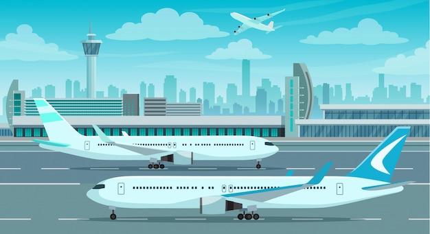 Edifício do terminal do aeroporto e aviões na pista