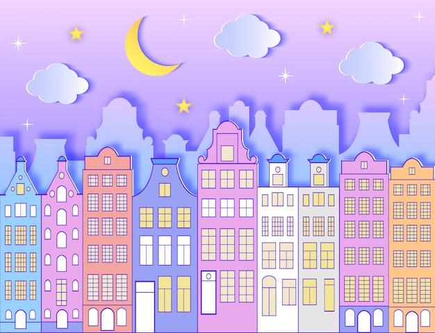 Edifício, lua, estrelas e nuvens.