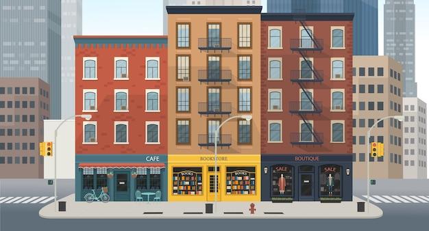 Edifícios urbanos com lojas: boutique, café, livraria.