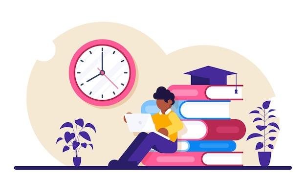 Educação online. o aluno com um laptop estuda o material pela internet.
