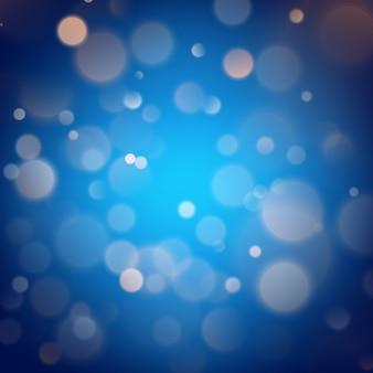 Efeito bokeh quente abstrato sobre fundo azul. luzes de glitter dourados.