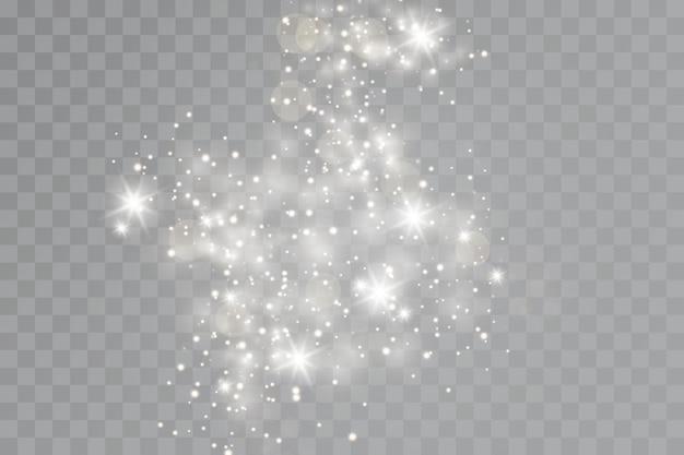 Efeito de brilho. um flash de poeira de natal, bokeh cintilante.