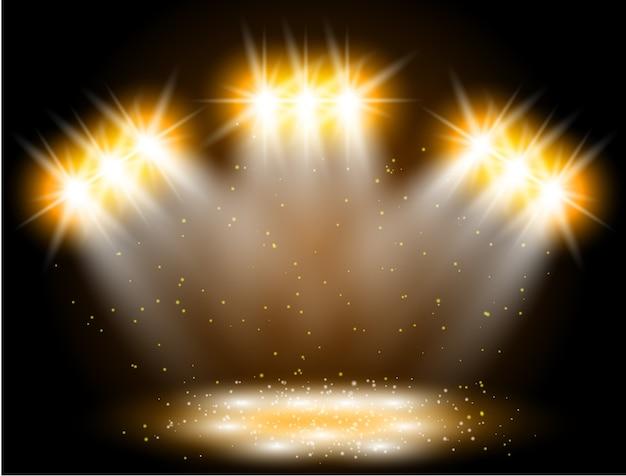 Efeito de luz de holofotes em fundo preto. cena de show com faíscas iluminadas por raio de brilho dourado