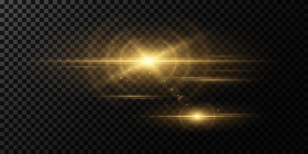 Efeito de luz dourada sobre um fundo escuro e transparente. faíscas brilhantes. feixes mágicos.