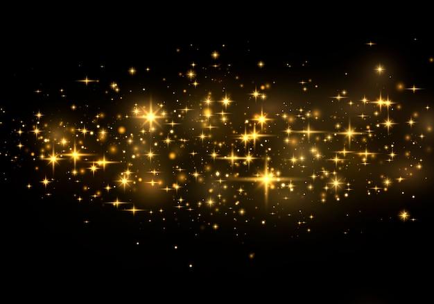 Efeito de luz elegante abstrato sobre um fundo preto. pó amarelo faíscas amarelas e estrelas douradas brilham com luz especial. sparkles partículas de poeira mágica efervescente.
