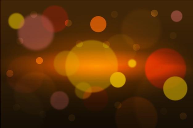 Efeito de luzes douradas de bokeh em fundo escuro