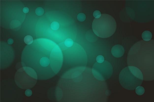 Efeito de luzes verdes de bokeh em fundo escuro