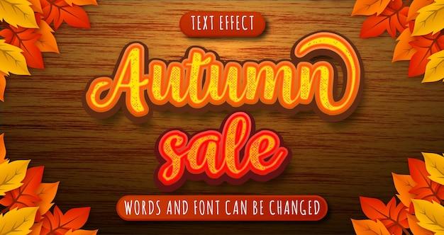 Efeito de texto de venda de outono isolado em madeira e folhas editáveis eps cc