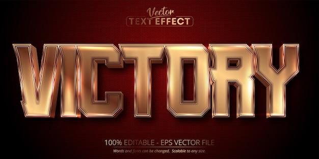 Efeito de texto editável de luxo ouro de texto vitória em plano de fundo texturizado vermelho escuro