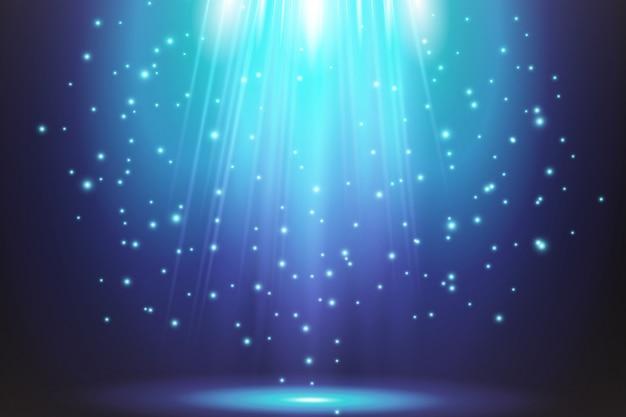 Efeitos claros azuis transparentes em um fundo escuro. holofotes, flare, explosão e estrelas.