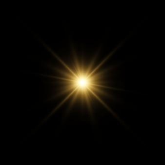Efeitos de luzes brilhantes douradas, em um fundo transparente.