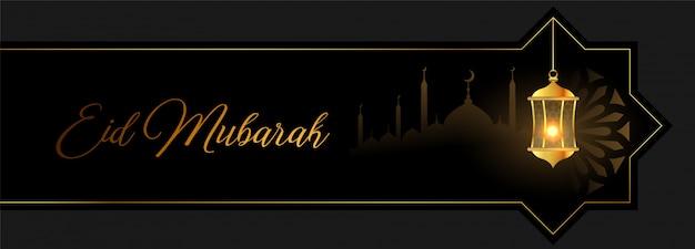 Eid mubarak banner dourado com lanterna e mesquita