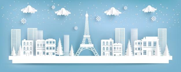 Eifel torre e cidade no inverno. projeto da arte de papel. Vetor Premium