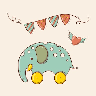 Elefante azul de brinquedo desenhado à mão em manchas brancas em rodas amarelas com uma guirlanda festiva e um coração voador