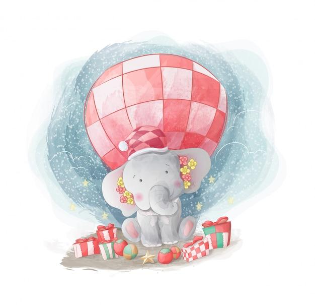 Elefante bebê feliz em receber presente de natal