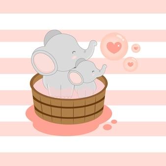 Elefante bonito e bebê tomando banho na banheira.