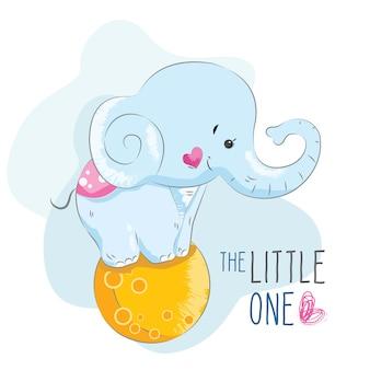 Elefante de bebê em pé sobre uma bola de lua
