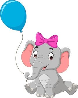Elefante de desenho animado com um balão azul