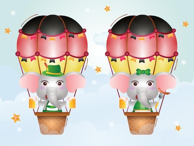 Elefante fofo no balão de ar quente com o tradicional vestido da oktoberfest