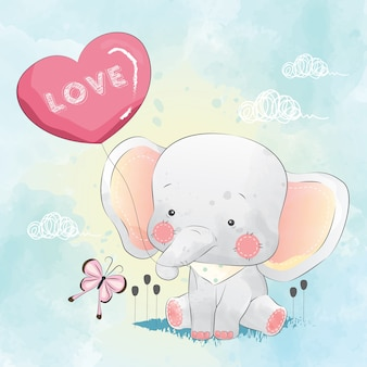 Elefante pequeno brincando com balão