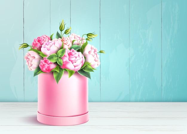Elegante caixa rosa no fundo da parede de madeira.