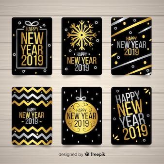 Elegante coleção de cartão de ano novo 2019 com estilo dourado