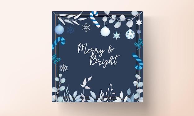 Elegante design de cartão de natal branco com folhas e enfeites de natal