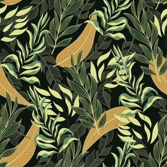 Elegante padrão tropical sem costura com belas plantas e folhas amarelas e verdes