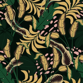 Elegante padrão tropical sem costura com plantas e folhas amarelas e verdes brilhantes