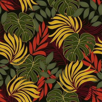 Elegante sem costura padrão tropical com folhas e plantas amarelas e vermelhas brilhantes