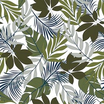 Elegante sem costura padrão tropical com plantas e folhas de azuis e verdes brilhantes