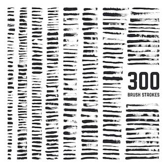 Elementos de escova artística do grunge, pincéis sujos de textura à mão livre preto e grande coleção de traços brutos