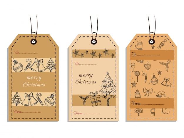 Elementos do doodle de natal em três etiquetas pendentes.