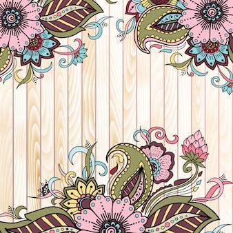 Elementos florais abstratos em estilo indiano mehndi em fundo de madeira.