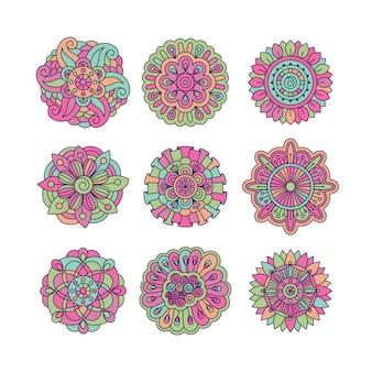 Elementos florais de doodle simétrico colorido