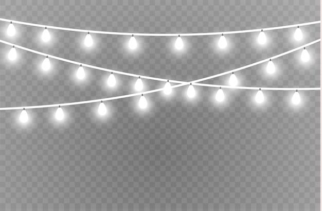 Elementos realistas de luzes de natal. luzes brilhantes para cartões de férias de natal, banners, cartazes, design web. guirlandas de decorações. lâmpada de néon led
