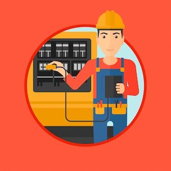 Eletricista com equipamentos elétricos.