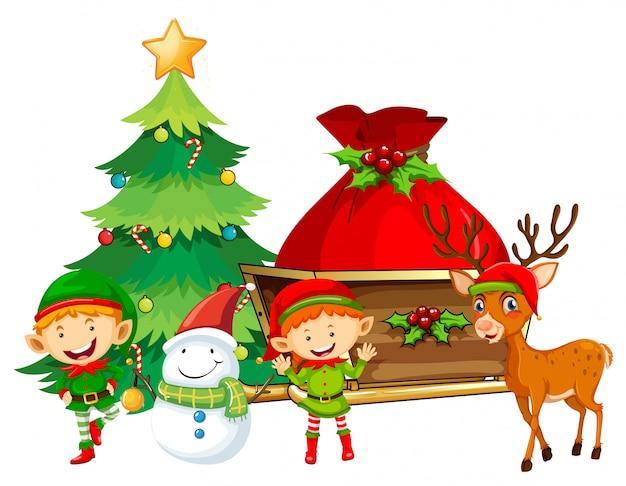 Elfos e boneco de neve pela árvore de natal