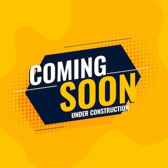 Em breve em construção, fundo amarelo