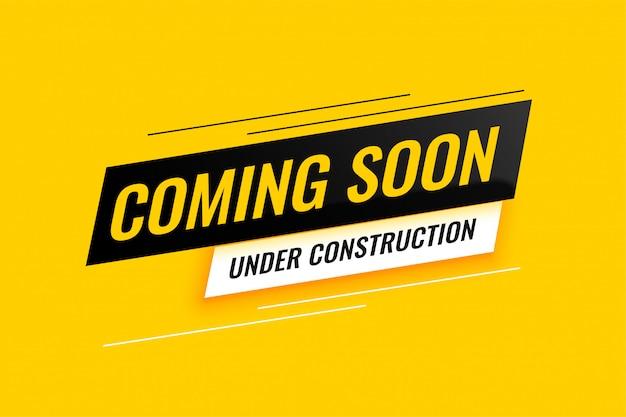 Em breve, sob construção design de fundo amarelo