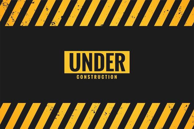 Em construção com listras pretas e amarelas
