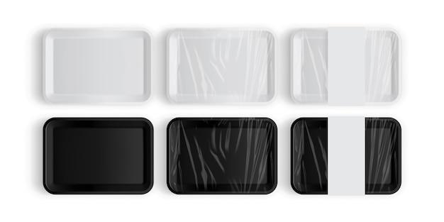 Embalagem de bandeja branca e preta para alimentos isolados