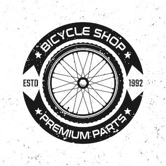 Emblema, crachá, etiqueta ou logotipo de vetor redondo de bicicleta com roda de bicicleta em estilo vintage isolado no fundo branco